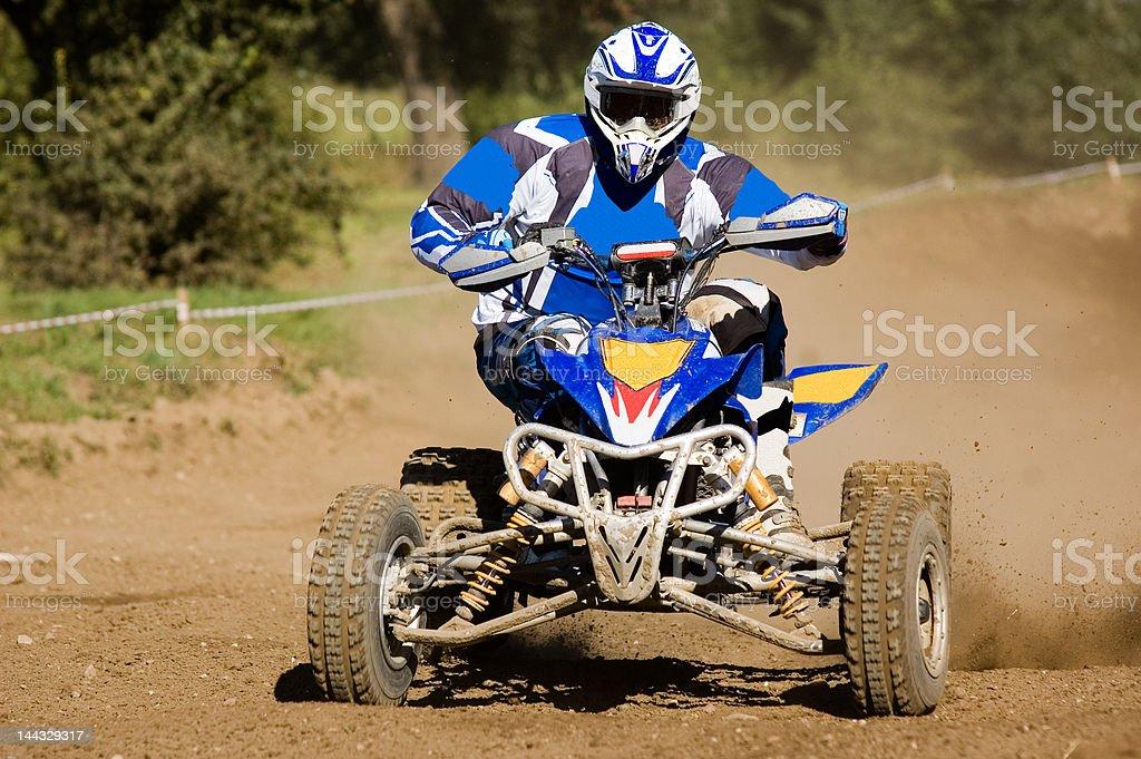Teenager riding his quad stock photo