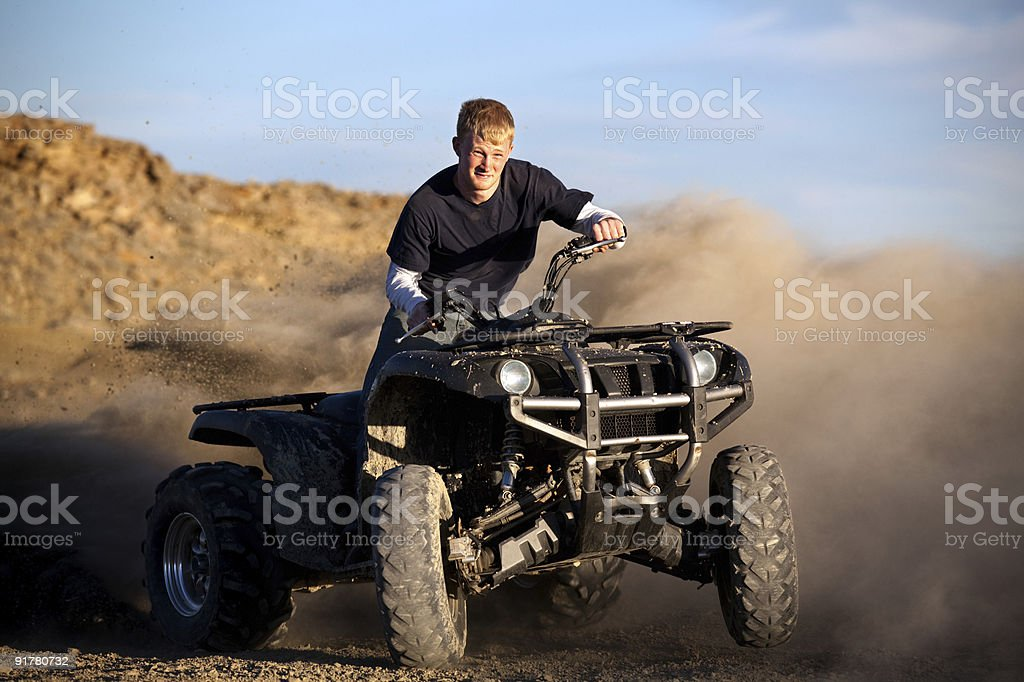 teenager riding quad royalty-free stock photo