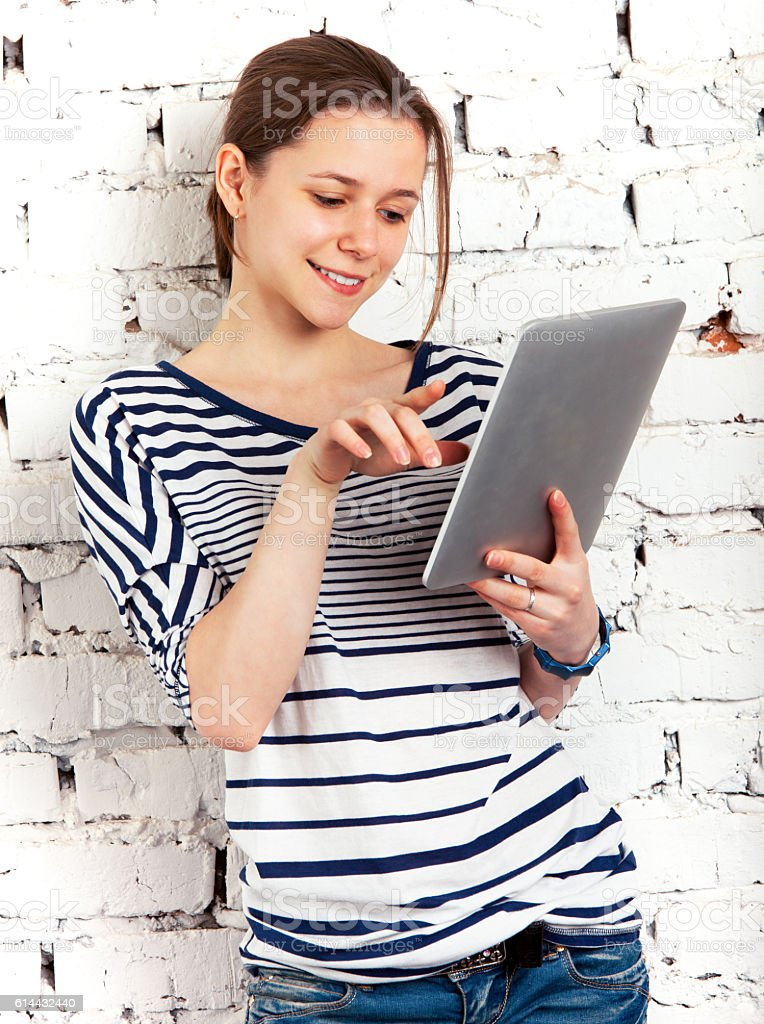 Teenager schoolgirl with tablet computer stock photo