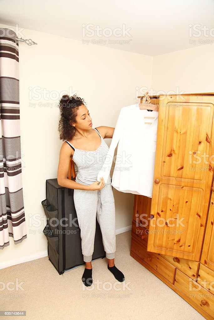 teenager selecting clothes from wardrobe stock photo