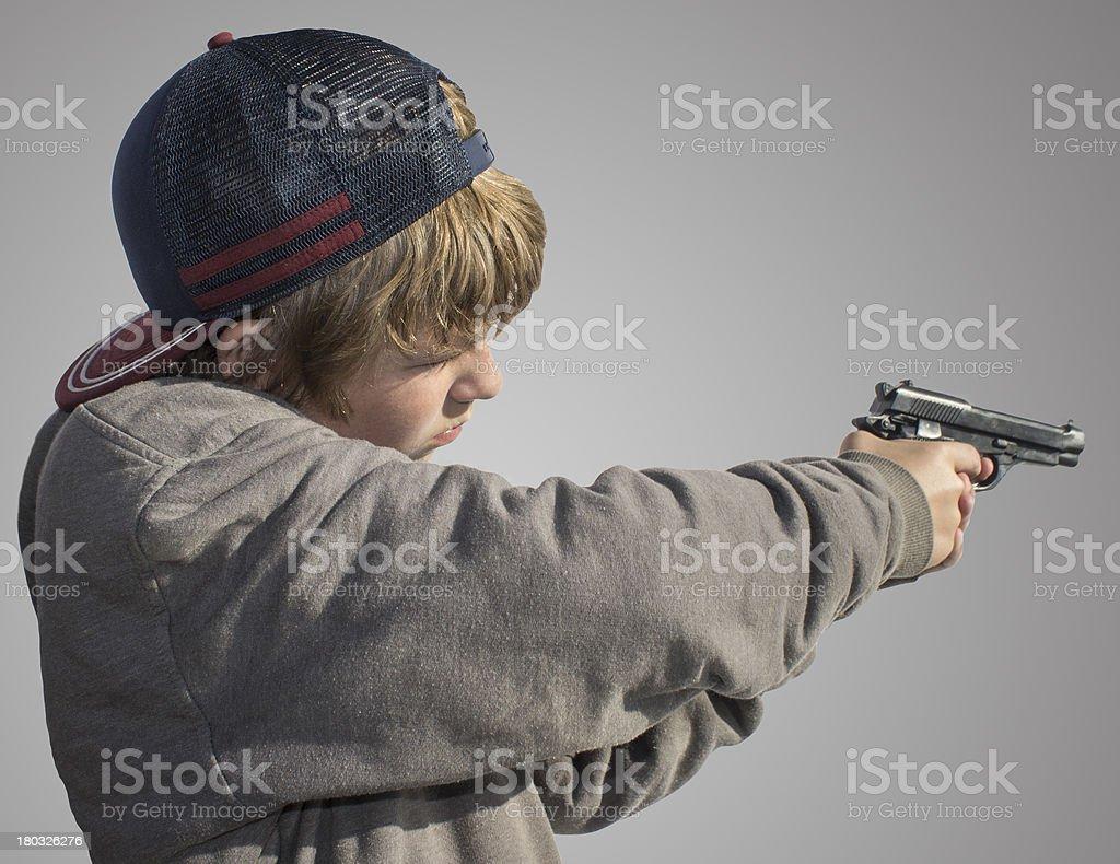 Teenager Shooting Handgun royalty-free stock photo