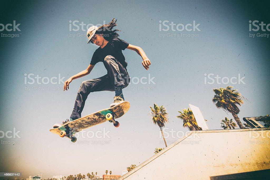 Teenager Skateboarding Venice Beach Skatepark in Los Angeles stock photo
