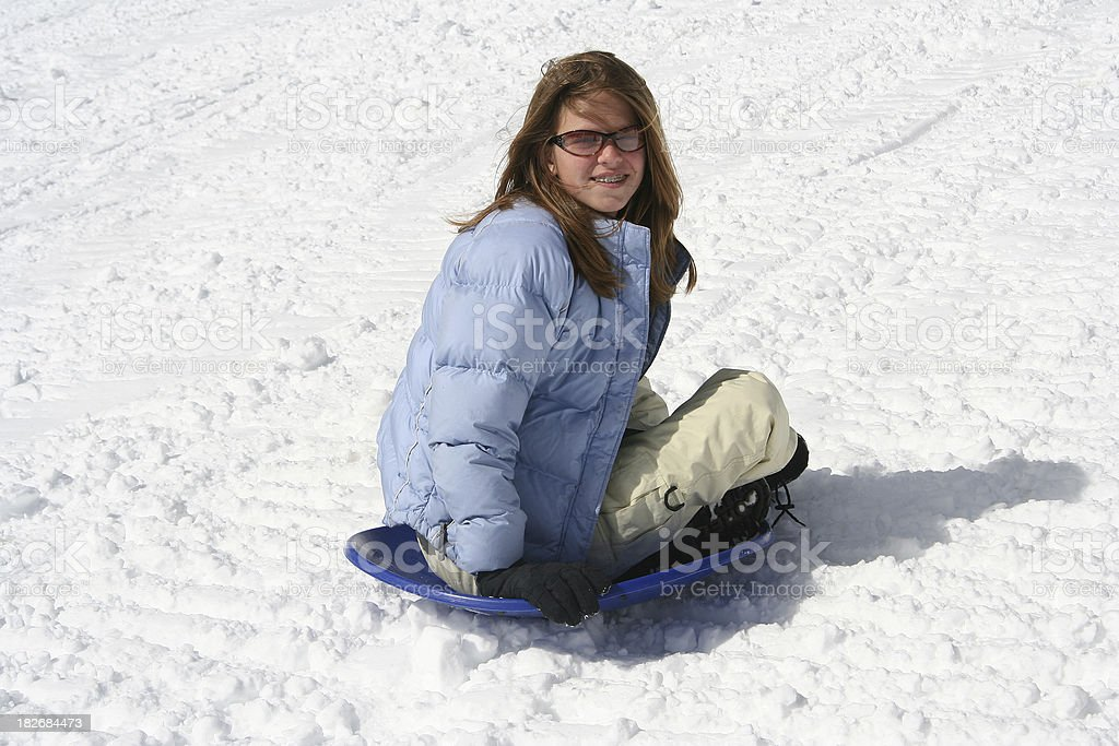 Teenager Sledding royalty-free stock photo