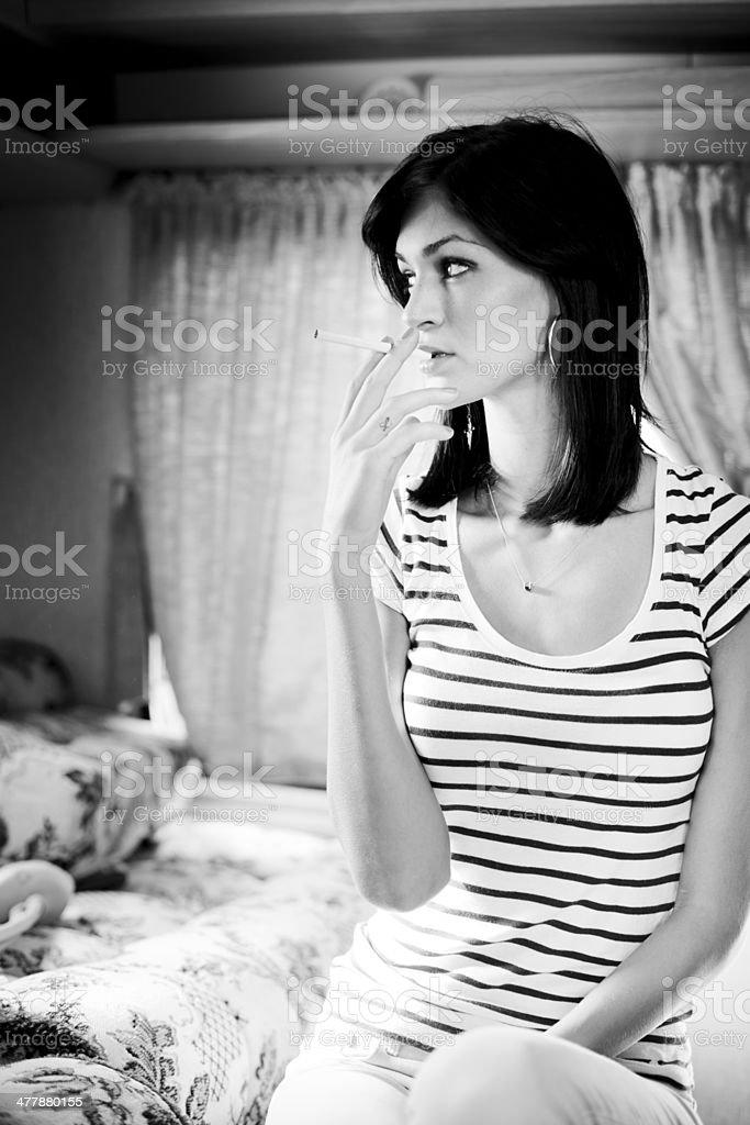 Teenager smoking royalty-free stock photo
