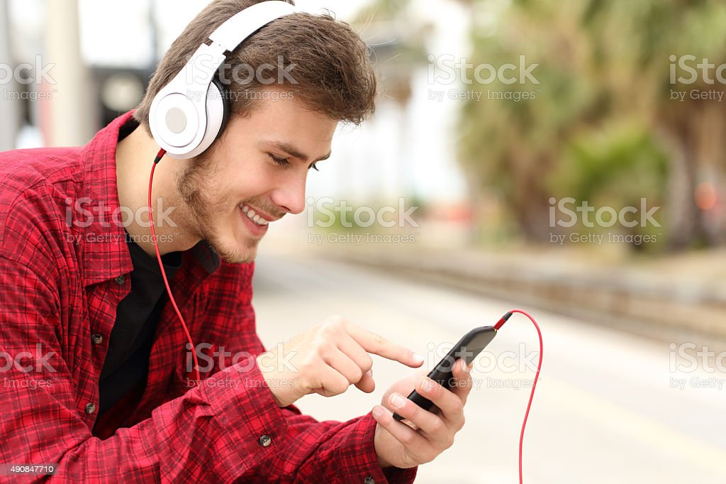 Teenager student learning with online course in a smart phone stock photo