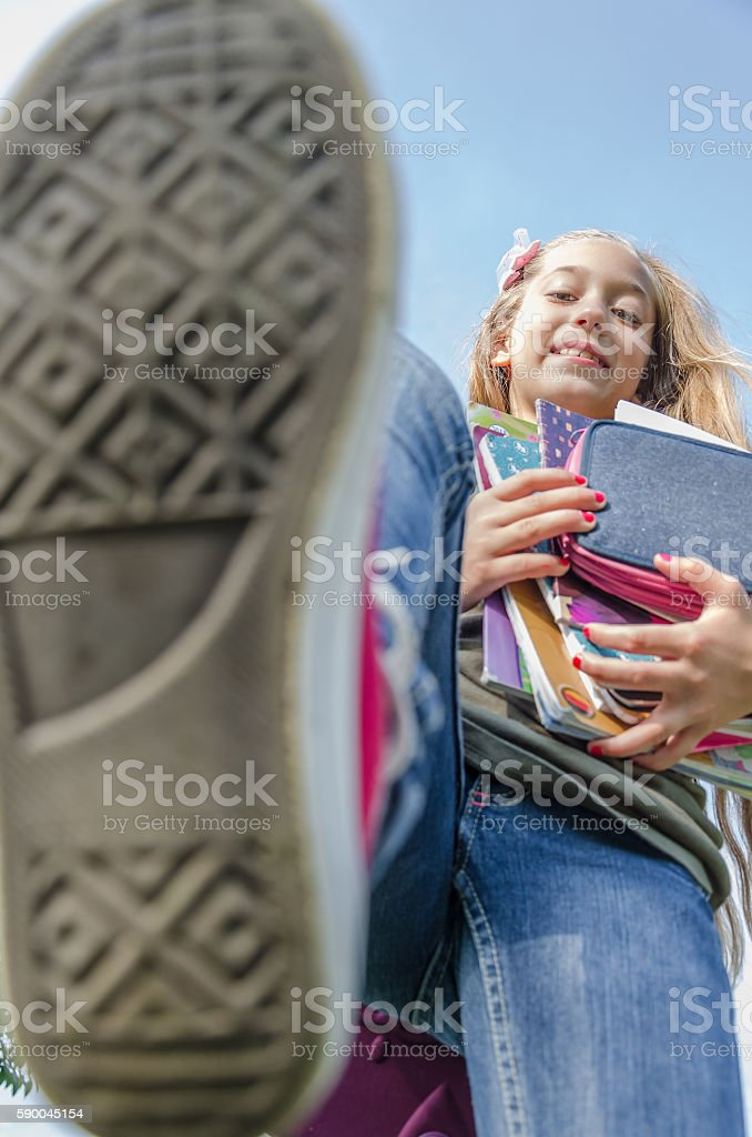 teenager student with books trampled on camera stock photo