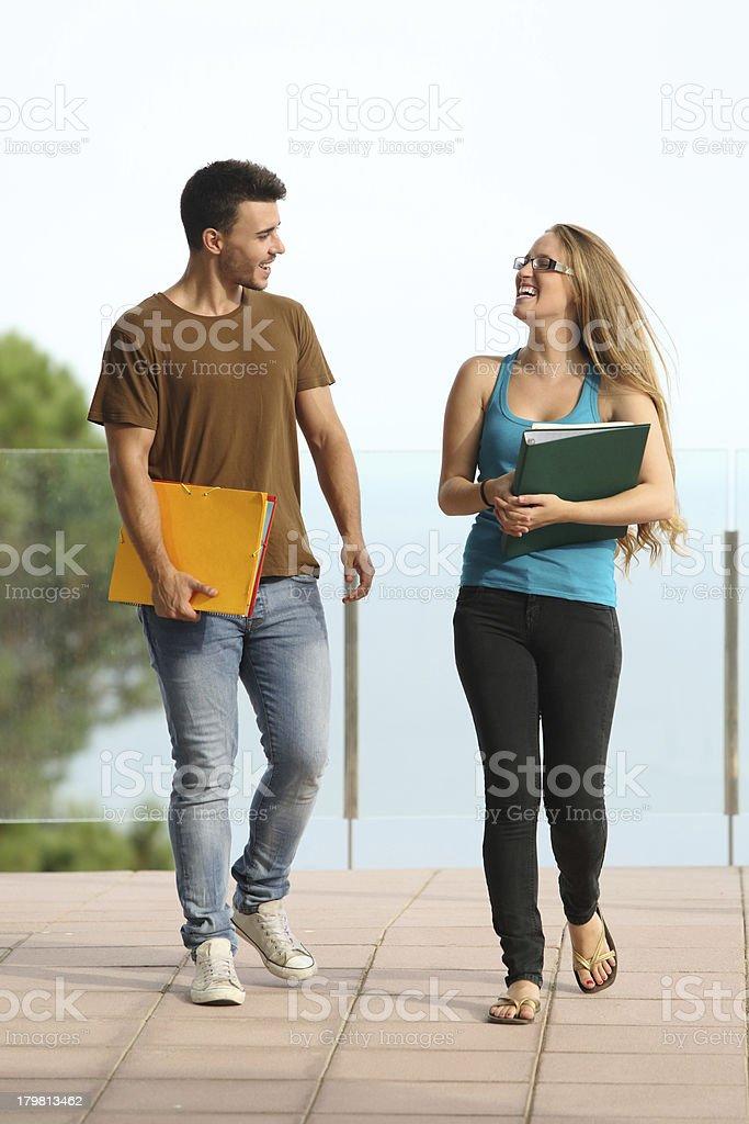 Teenager students boy and girl walking towards camera royalty-free stock photo