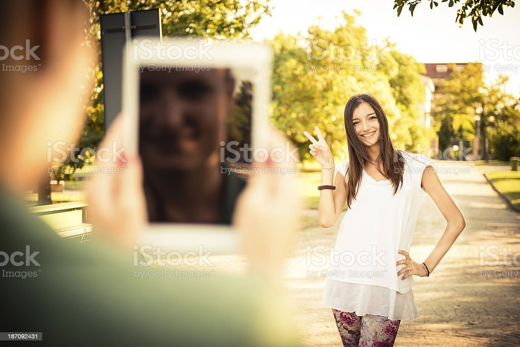 Teenager take a photo of her friend royalty-free stock photo