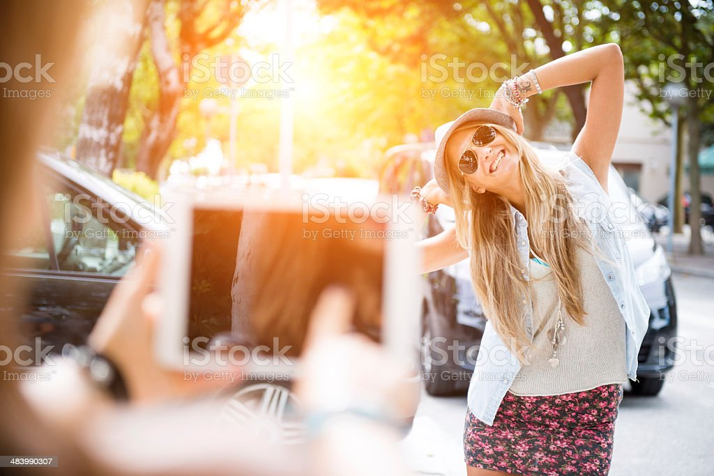 Teenager take a photo to her friend royalty-free stock photo