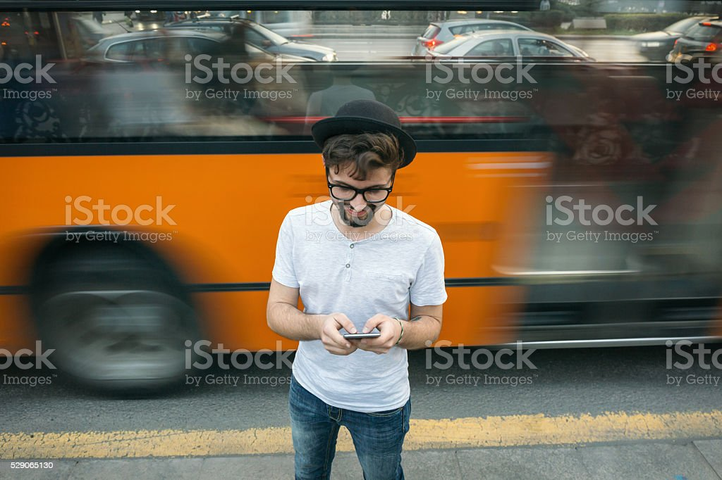 Teenager texting on cell phone stock photo