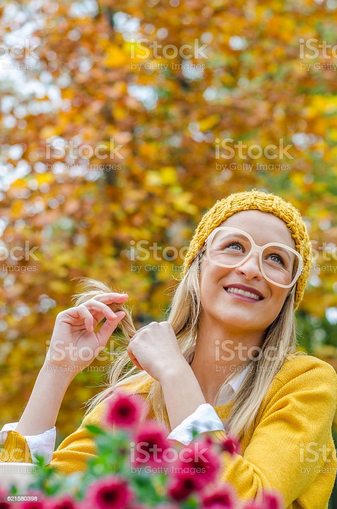 Teenager twisting her hair stock photo