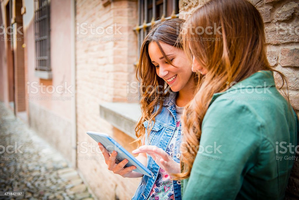 Teenager using digital tablet royalty-free stock photo
