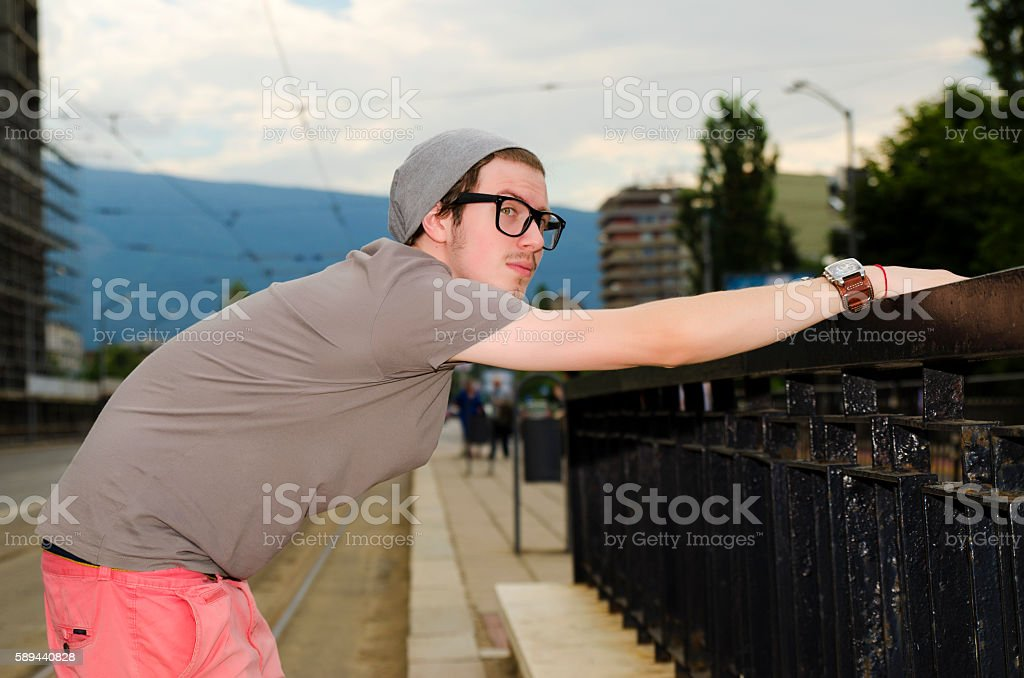 Teenager waiting at a tram station stock photo