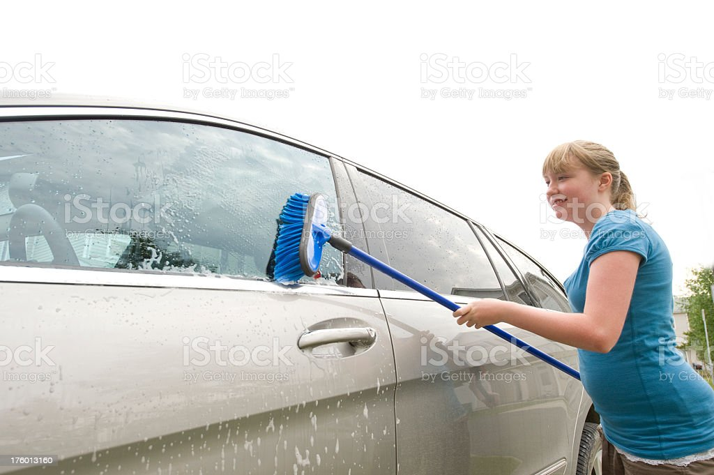 Teenager Washing a Car royalty-free stock photo