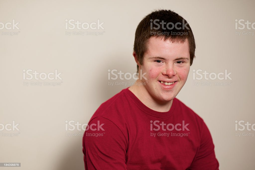 Teenager with a maroon top on plain background stock photo