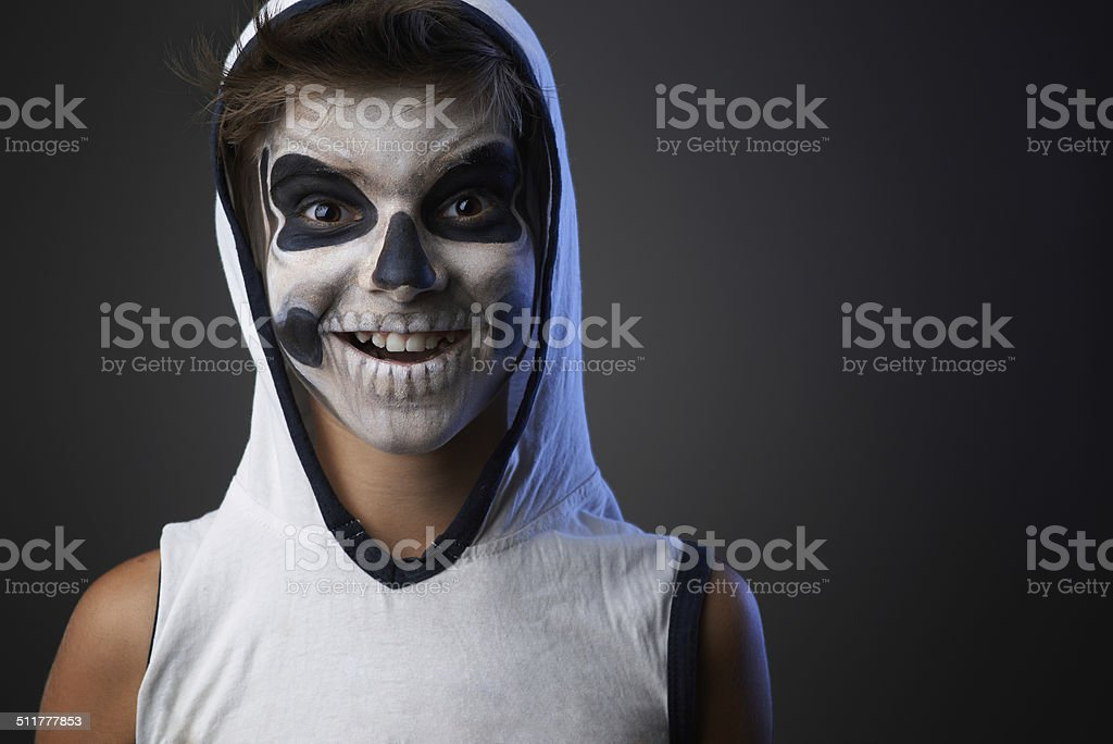 teenager with a skull makeup stock photo