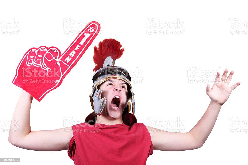 Teenager with centurion helmet and foam hand stock photo
