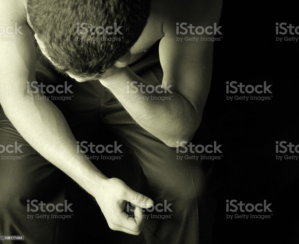 Teenager with hand on his head feeling desperate stock photo