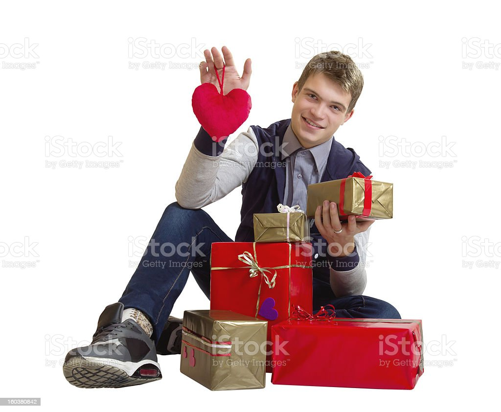 Teenager with heart and gifts isolated royalty-free stock photo