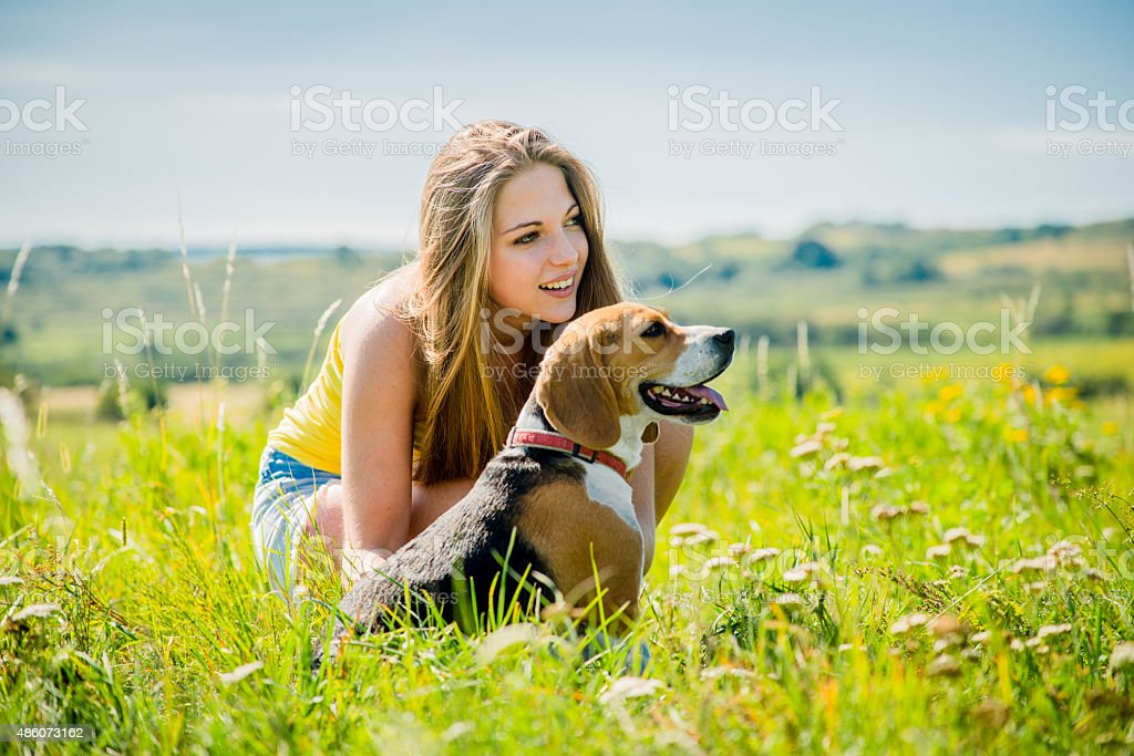 Teenager with her dog stock photo