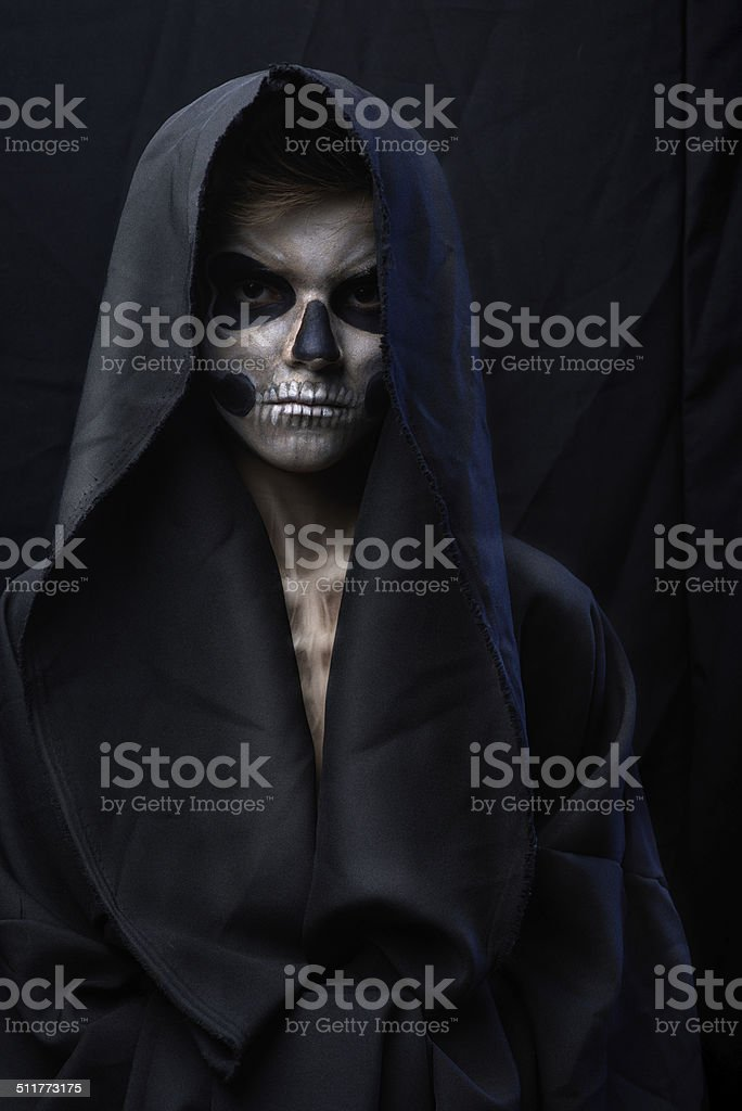 teenager with makeup skull cape stock photo