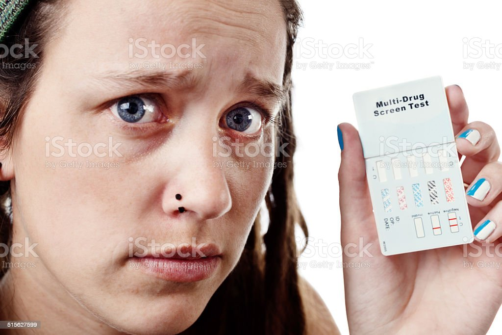 Teenager with multi-drug test kit worries about results stock photo