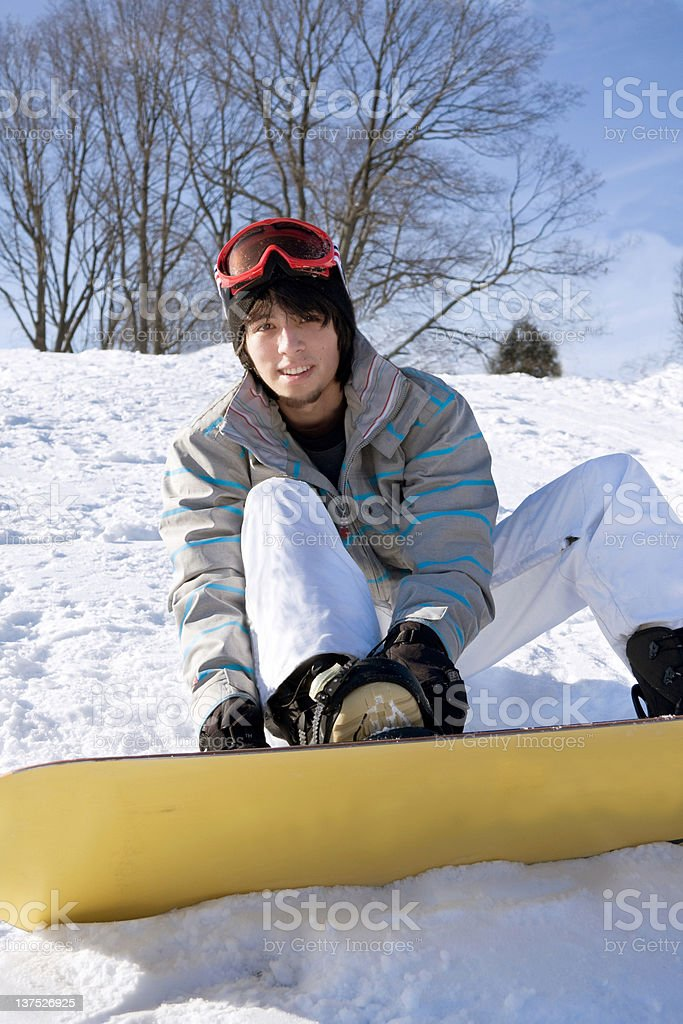 teenager with snowboard on mountain royalty-free stock photo