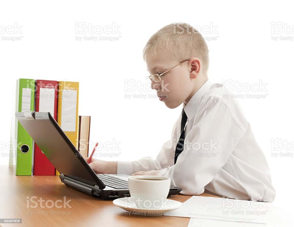 Teenager working in usual office space royalty-free stock photo