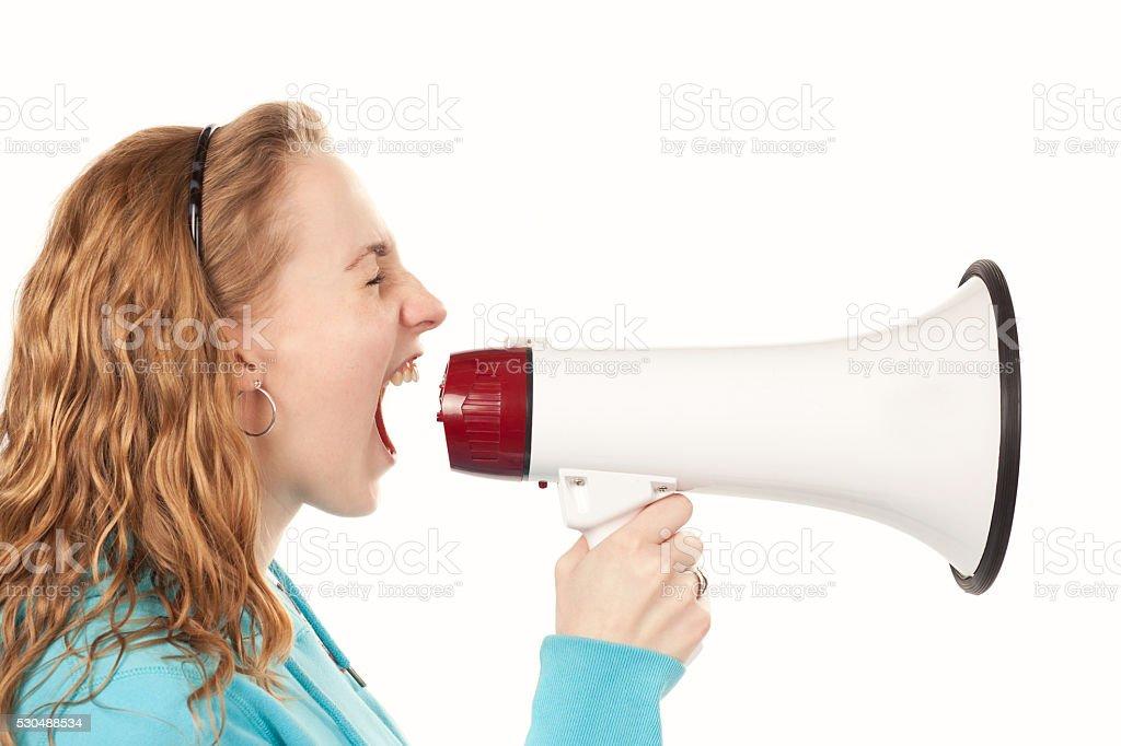Teenager yells through megaphone stock photo