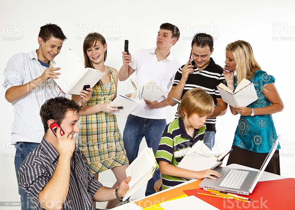 Teenagers, adults and elementary age child multitasking royalty-free stock photo
