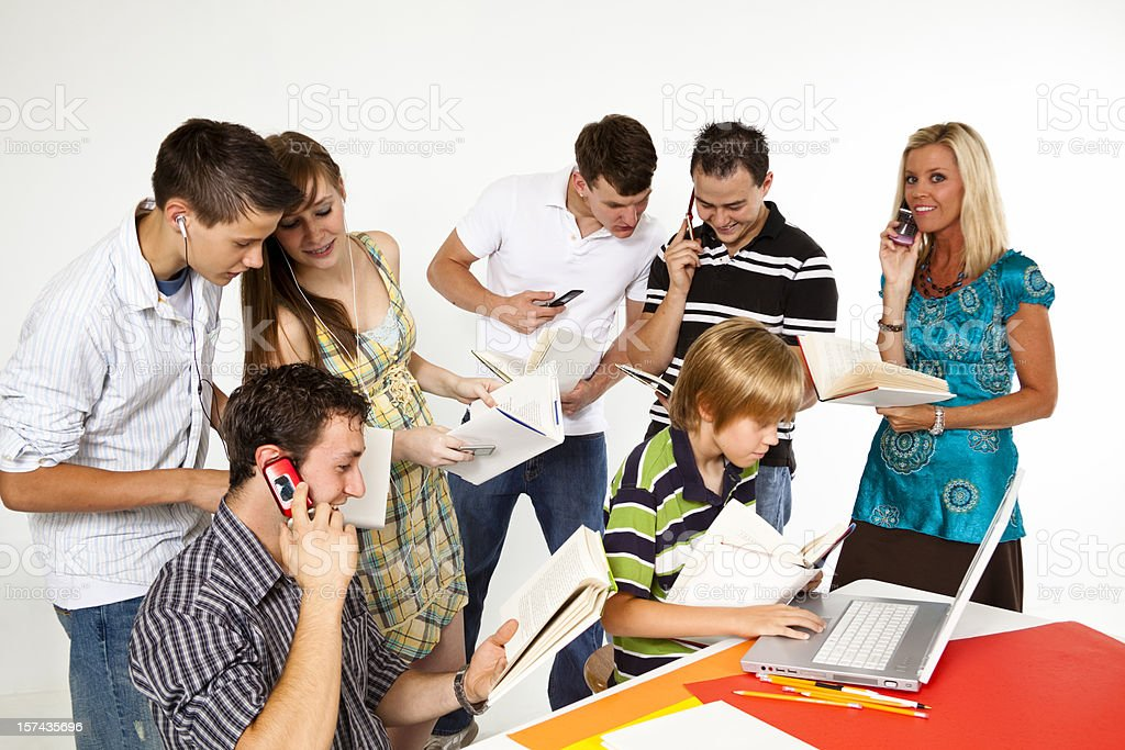 Teenagers Adults Child Reading Books And Using Modern