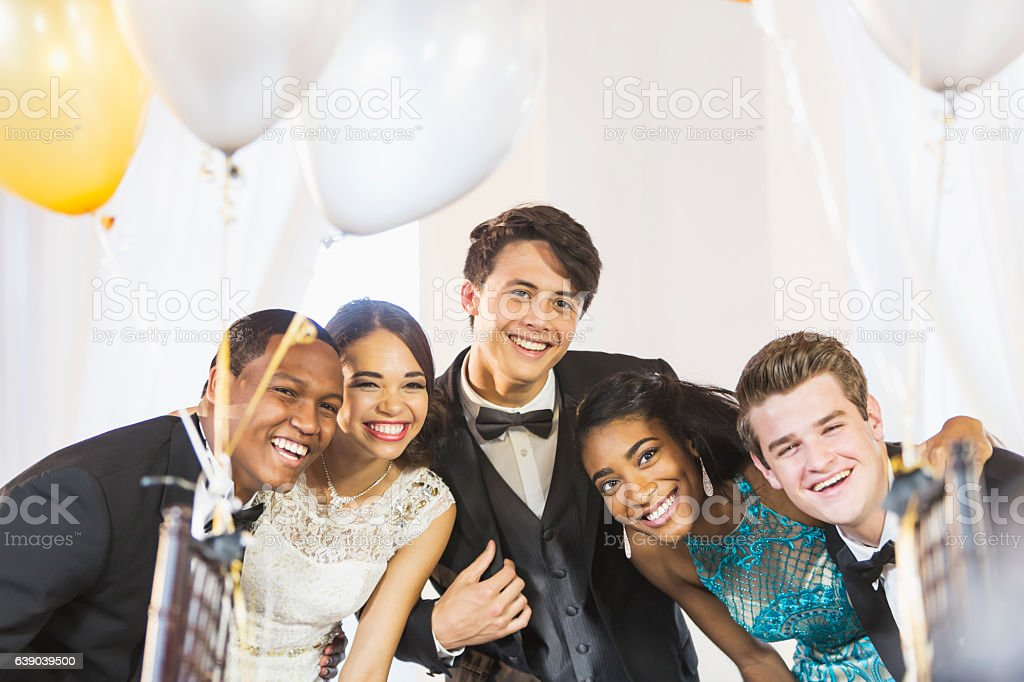 Teenagers and young adults having fun at party stock photo