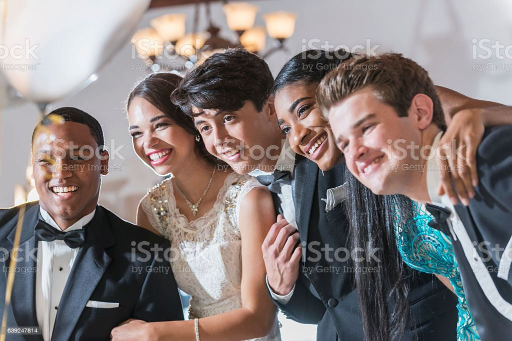 Teenagers and young adults in formalwear stock photo