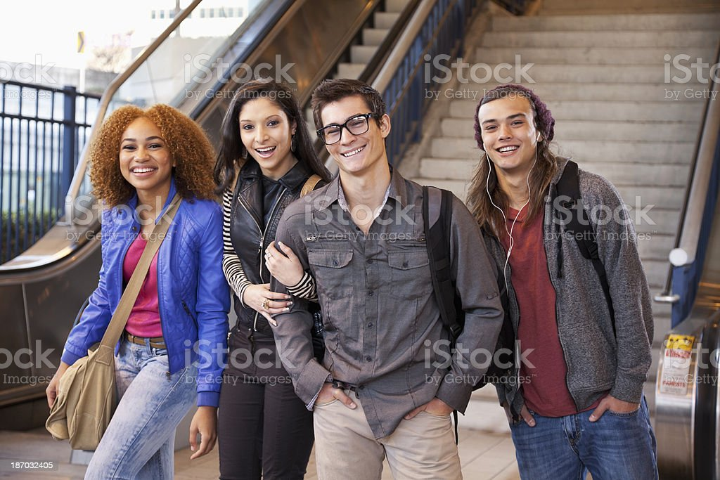 Teenagers at bottom of stairs stock photo