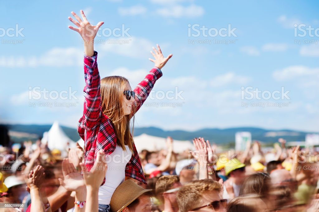 Teenagers at summer music festival enjoying themselves stock photo