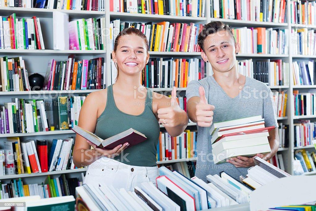 Teenagers buying new books stock photo