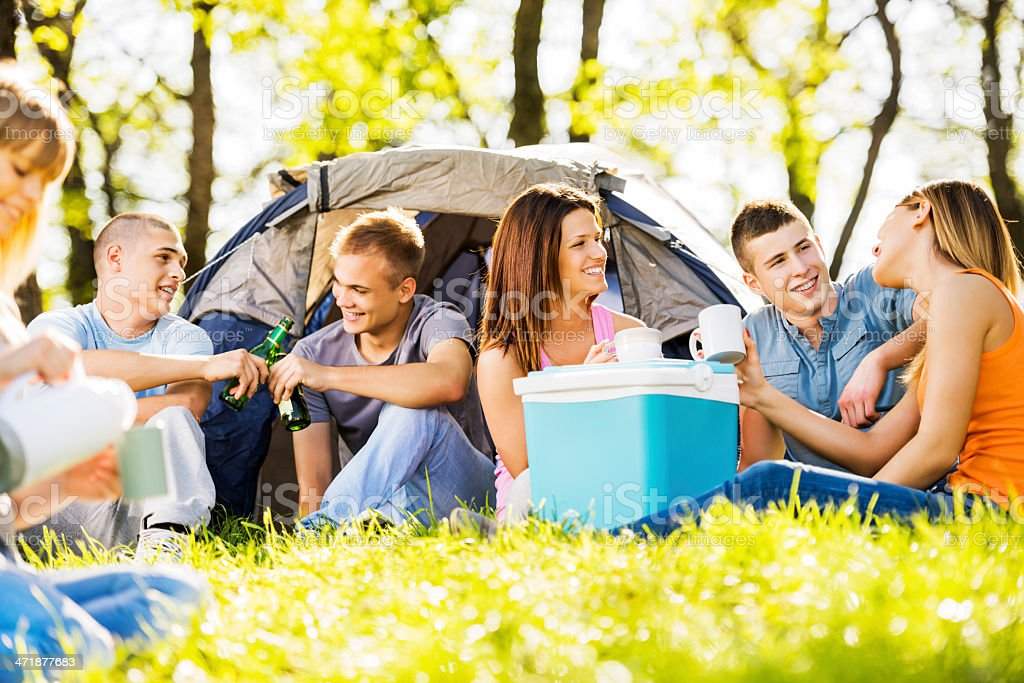 Teenagers camping in nature. royalty-free stock photo