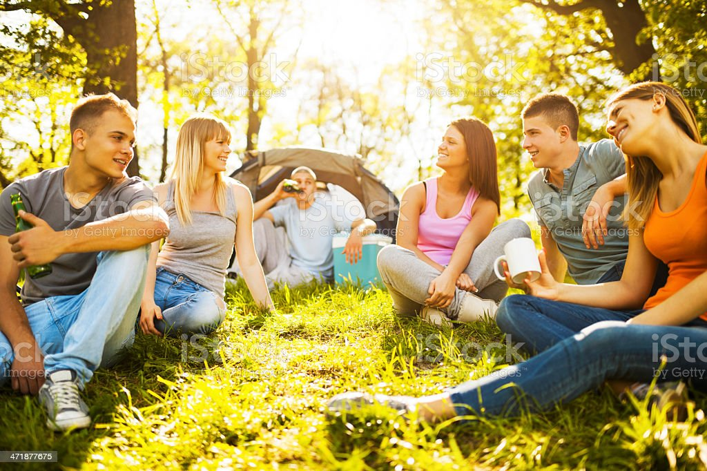 Teenagers camping in the nature. royalty-free stock photo