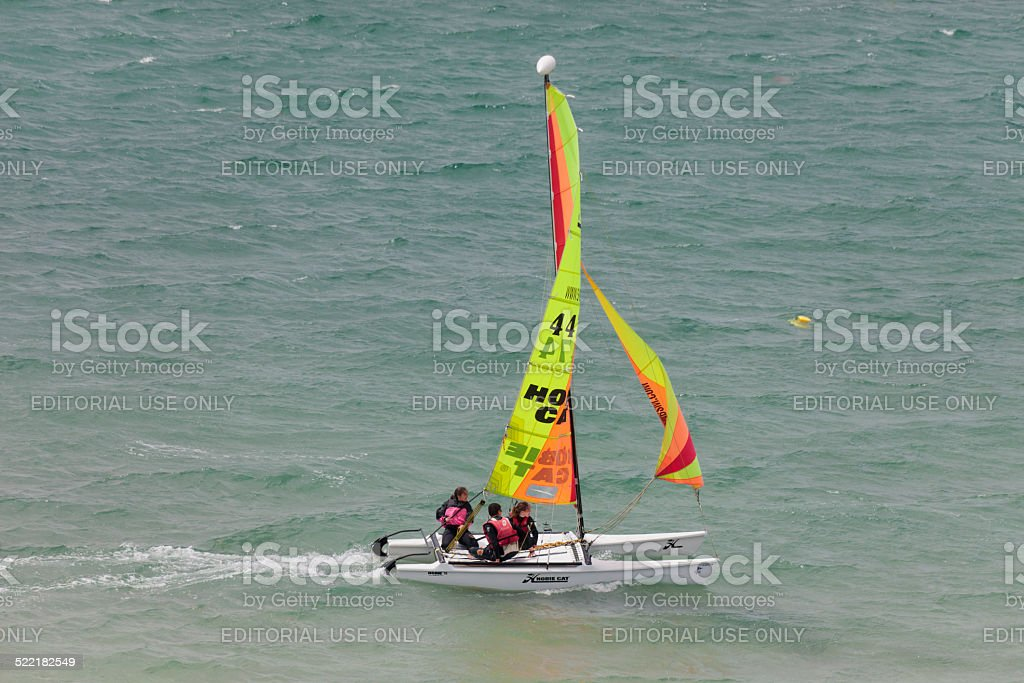 Teenagers catamaran sailing on Atlantic Ocean stock photo
