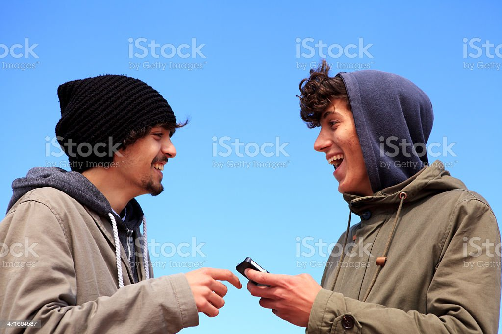 teenagers chatting with smartphone royalty-free stock photo