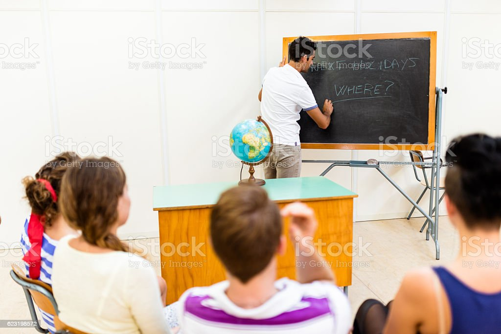 teenagers college student listening the lesson on classroom stock photo