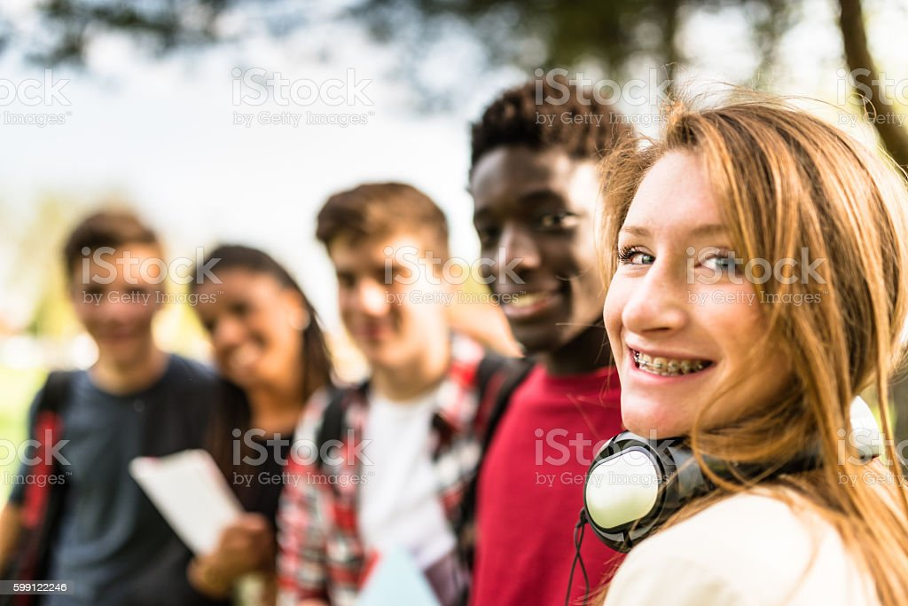 teenagers college student smiling embracing stock photo