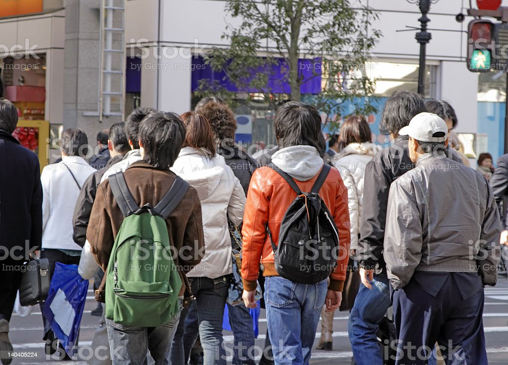 Teenagers crossing the street royalty-free stock photo