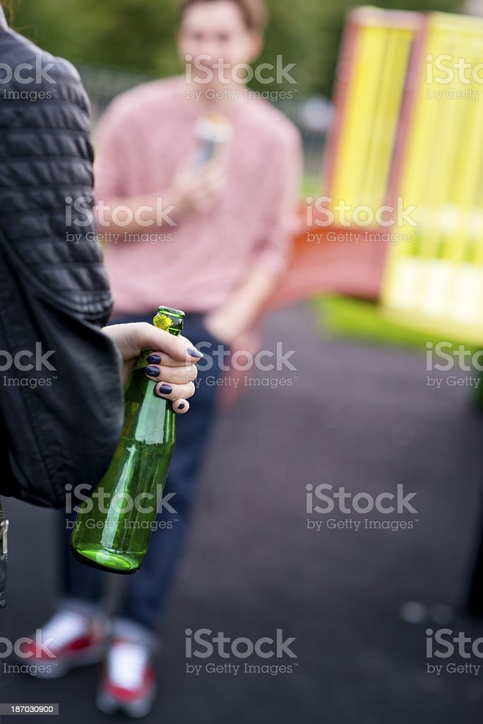 teenagers drinking in the park royalty-free stock photo