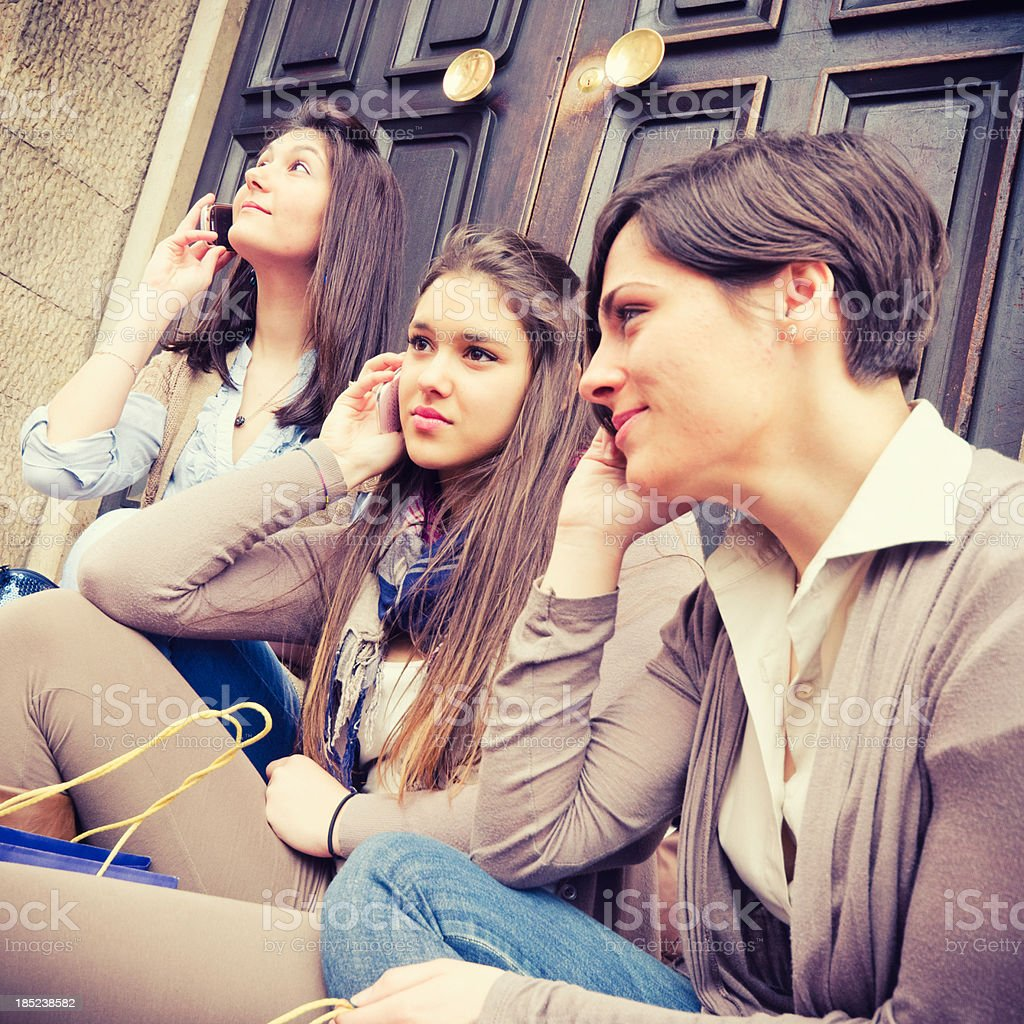 Teenagers girl outside their home after shopping on the phone royalty-free stock photo