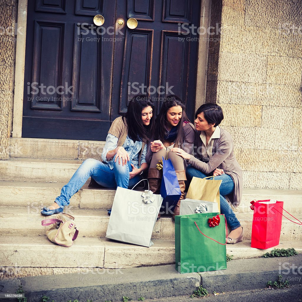 Teenagers girl outside their home after shopping text messaging royalty-free stock photo