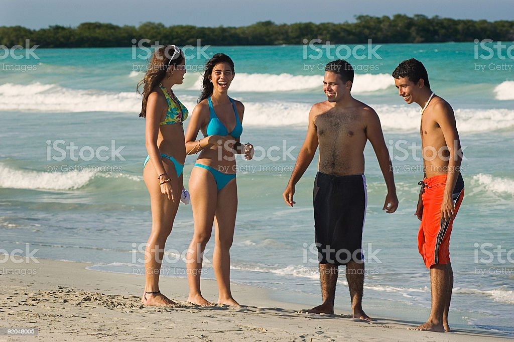 Teenagers having fun at a tropical beach stock photo
