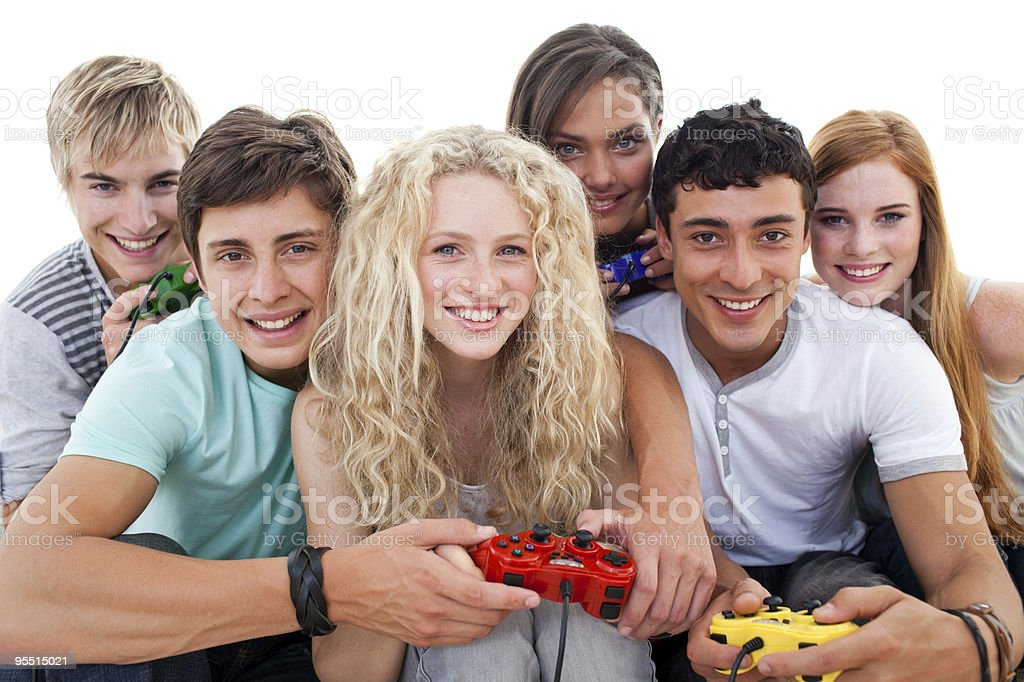 Teenagers having fun playing video games royalty-free stock photo