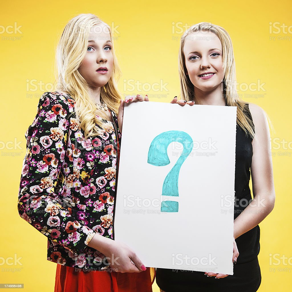Teenagers holding a question mark royalty-free stock photo