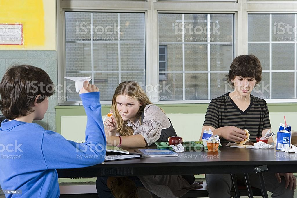 Teenagers in cafeteria royalty-free stock photo